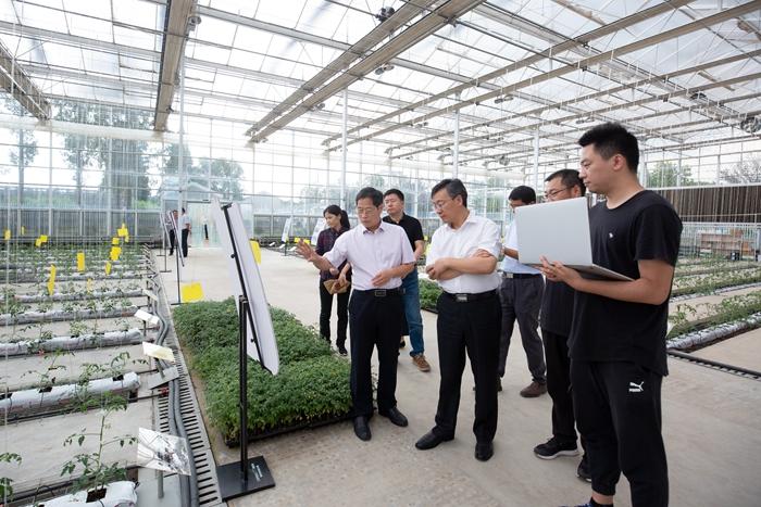 农业农村部科技教育司司长周云龙一行来我院调研指导